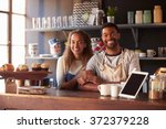 portrait of couple running... | Shutterstock . vector #372379228