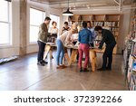 business team meeting around... | Shutterstock . vector #372392266