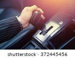 hand shifting the gear stick... | Shutterstock . vector #372445456