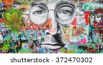 Small photo of PRAGUE, CZECH REPUBLIC - JANUARY 25, 2016: Wall painting of John Lennon`s face in Prague center. Prague is the capital of the Czech republic.