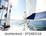 senior man on sail boat or... | Shutterstock . vector #372482116