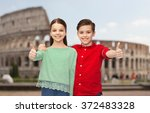 happy boy and girl showing... | Shutterstock . vector #372483328