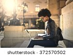 using technology outdoors | Shutterstock . vector #372570502