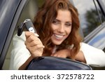 young woman holding the keys to ... | Shutterstock . vector #372578722