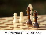 chess pieces and game board on... | Shutterstock . vector #372581668