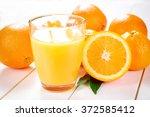 orange juice and orange fruit... | Shutterstock . vector #372585412