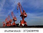 port crane bridge and bulk... | Shutterstock . vector #372608998