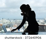 silhouette of businesswoman... | Shutterstock . vector #372640906