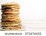 high stack of pancakes .... | Shutterstock . vector #372676432