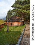 "Small photo of traditional Altai building from logs ""ail"""