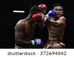 Small photo of BANGKOK - JAN 31: Khrop Sut Fae Thek (R) fights with Khotchasan Phuket Drakon Muaythai in thai boxing competition - Battle Of Petchwised at Rajadamnern stadium on January 31, 2016 in Bangkok.
