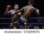 Small photo of BANGKOK - JAN 31: Khrop Sut Fae Thek (L) fights with Khotchasan Phuket Drakon Muaythai in thai boxing competition - Battle Of Petchwised at Rajadamnern stadium on January 31, 2016 in Bangkok.