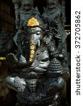 Small photo of BALI, INDONESIA - February 6, 2016: A stone sculpture of the Hindu Elephant God Ganesh ('Ganesha') waits for a buyer at a stone-carver's workshop in the tourist resort of Ubud, Bali, Indonesia.