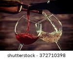 white and red wine pouring in... | Shutterstock . vector #372710398