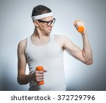 funny weak man tries to lift a... | Shutterstock . vector #372729796