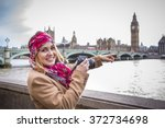 happy  smiling tourist woman in ... | Shutterstock . vector #372734698