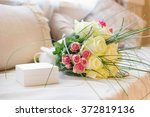gift box and bouquet flowers on ... | Shutterstock . vector #372819136