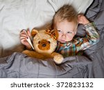 sick child boy lying in bed... | Shutterstock . vector #372823132