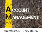 Small photo of Concept image of Business Acronym AM Account Management written over road marking yellow paint line.