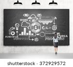businesswoman drawing a... | Shutterstock . vector #372929572