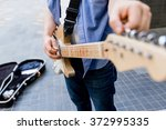 young musician with guitar in... | Shutterstock . vector #372995335
