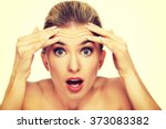 a young woman checking wrinkles ... | Shutterstock . vector #373083382