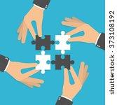 Hands Putting Puzzle Pieces...
