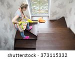 young beautiful woman cleaning... | Shutterstock . vector #373115332