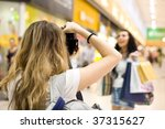 girl photographer shoot model in mall - stock photo