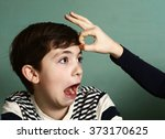Small photo of boy got fillip flick on his forehead because of lost bet wager