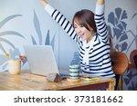 euphoric winner watching a... | Shutterstock . vector #373181662