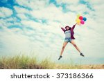 beautiful girl jumping with... | Shutterstock . vector #373186366