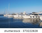 white yachts in the port | Shutterstock . vector #373222828