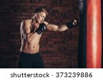 boxer training on a punching... | Shutterstock . vector #373239886