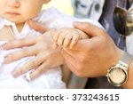 tiny baby's hand in parent's... | Shutterstock . vector #373243615