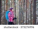 hiker in winter forest. sport ... | Shutterstock . vector #373276996