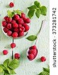 ripe juicy raspberries in a...   Shutterstock . vector #373281742