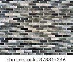 thin rectangular bricks wall... | Shutterstock . vector #373315246