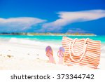 beach bag and flip flops on... | Shutterstock . vector #373344742