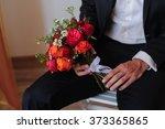 groom with bouquet | Shutterstock . vector #373365865