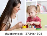 mother and kid playing logical... | Shutterstock . vector #373464805