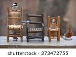 Birds And Rustic Chairs