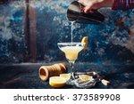 bartender pouring fresh lime... | Shutterstock . vector #373589908