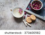 tea with rose toned photo | Shutterstock . vector #373600582