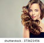 beautiful girl with long wavy... | Shutterstock . vector #373621456