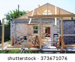 Small photo of Building New House from Autoclaved Aerated Concrete Blocks with Roofing Construction. Wooden Roof Frame House Construction