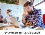 concentrated bearded young man... | Shutterstock . vector #373686505