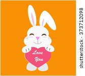 rabbit holding a heart with... | Shutterstock .eps vector #373712098