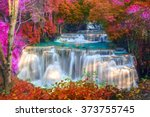 Waterfalls In Deep Forest At...