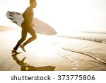a surfer with his surfboard... | Shutterstock . vector #373775806